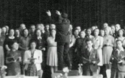 "The only known photo of Theresienstadt inmates performing Verdi's Requiem for the Dead, taken during the final performance on June 23, 1944. Raphael ""Rafi"" Schachter  is seen conducting the choir, with Adolf Eichmann and an International Red Cross delegation in the audience (courtesy: The Terezin Foundation)"