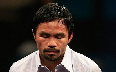 Manny Pacquiao answers questions during a post-fight news conference after losing to Floyd Mayweather, Jr. in their welterweight unification championship bout on May 2, 2015 at MGM Grand Garden Arena in Las Vegas, Nevada. (Jamie Squire/Getty Images/AFP)