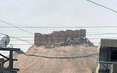 This picture released on Thursday, May 21, 2015 by the website of Islamic State fighters, shows the Palmyra castle is seen from the Syrian town of Palmyra (The website of the Islamic State group via AP)