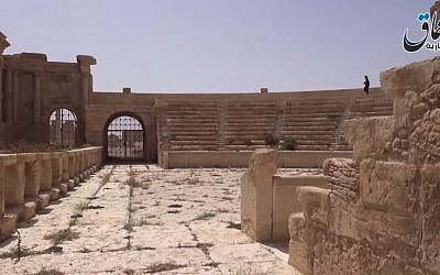 A view of the ruins of Palmyra, Syria, with what appears to be an Islamic State fighter walking through the city's ancient theater in a video released by the Islamic State's propaganda arm on May 27, 2015. (screen capture: YouTube)