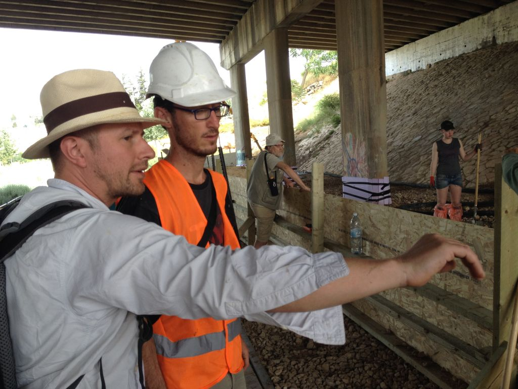 Architect Christophe Barlieb and artist Matan Israeli from Muslala consult at the Meeting Point (Jessica Steinberg/Times of Israel)