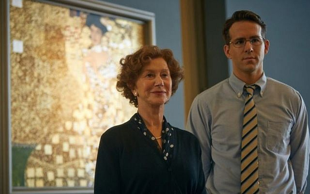 Actress Helen Mirren with co-star Ryan Reynolds standing in front of the famous 'Portrait of Adele Bloch-Bauer I' by Gustav Klimt. (Photo credit: The Weinstein Company)