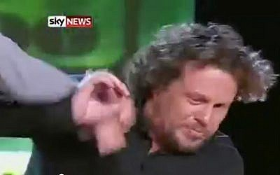 Newspaper owner Alexander Lebedev punches Sergei Polonsky on Russian television in 2011. Polonsky, who fled Israel in 2013 when a warrant for his arrest was issued in Russia, was deported from Cambodia to face embezzlement charges in May 2015. (Screen capture: YouTube/ Sky News)