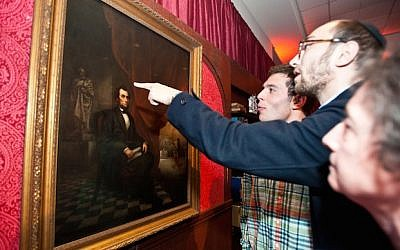 At a Brandeis event on April 28, 2015, visitors view Solomon Nunes de Carvalho's 1865 portrait of Abraham Lincoln. (JTA/Ashley McCabe/Brandeis University)