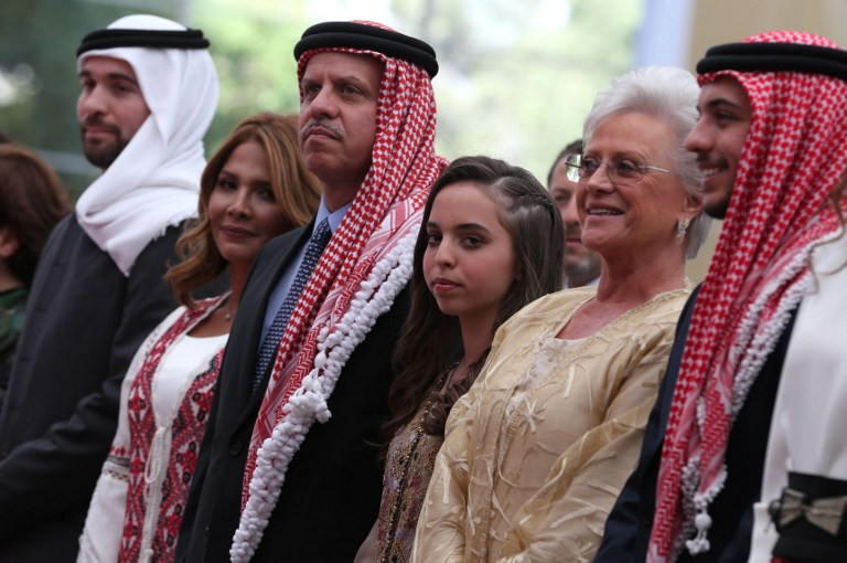 (From L to R) Jordan's Prince Ali bin al-Hussein, Princess Zina, Prince Faisal, Princess Salma, King Abdullah's mother, Princess Mona, and Crown Prince Hussein attend a ceremony to celebrate the country's 69th Independence Day, in Amman, on May 25, 2015. AFP PHOTO / KHALIL MAZRAAWI