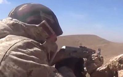 Hezbollah fighters attack Syrian rebels in Qalamoun. (screen capture: YouTube)