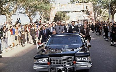 President Anwar Sadat stands in his car during his visit to Mansura, Lower Egypt in December 1978. (AP Photo/Bill Foley)