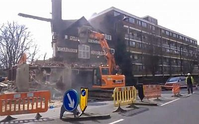A screen shot of a Tel Aviv-based development firm demolishing the historic Carlton Tavern in Westminster, London without permission in April 2015. (screen shot: The Daily Mail)