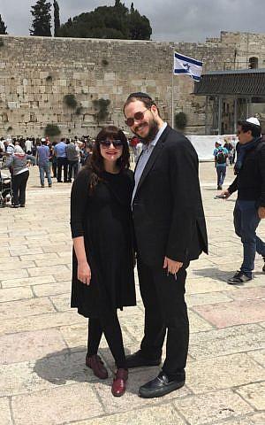 Rabbi Yaakov and Mushkee Raskin at the Western Wall on visit to Israel, May 2015. (Courtesy)