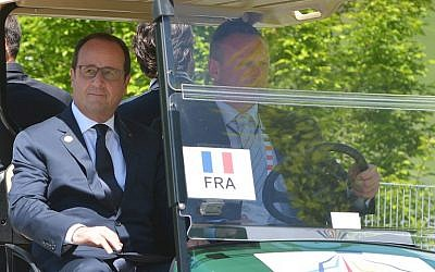 France's President Francois Hollande arrives in a golf cart at the Elmau Castle resort near Garmisch-Partenkirchen on June 7, 2015 at the start of a G7 Summit (AFP PHOTO / MANDEL NGAN)