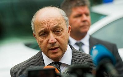 French Foreign Minister Laurent Fabius addresses the media in front of the Palais Coburg Hotel, the venue of the nuclear talks in Vienna, Austria on June 27, 2015 (Christian Bruna/AFP)