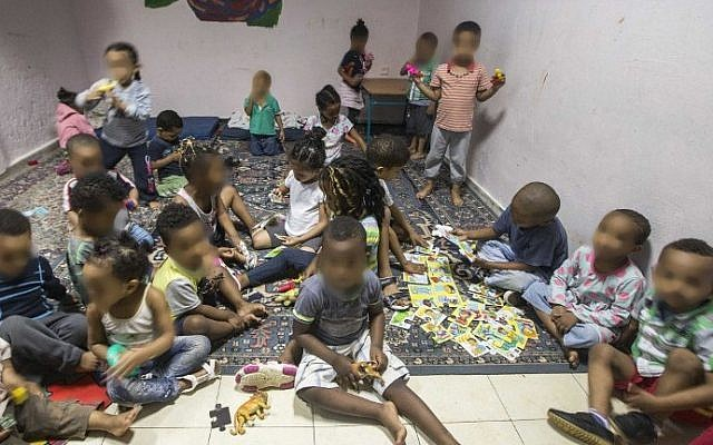 Children from families of African migrants gather at a so-called day-care center in southern Tel Aviv, on May 28, 2015. (Jack Guez/AFP)