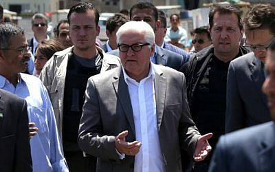 German Foreign Minister Frank-Walter Steinmeier, center, gestures during a visit to the sea port in Gaza City, June 1, 2015. (AFP/MAHMUD HAMS)