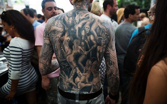 A man whose back is completely covered with tattoos takes part in the three-day annual tattoo festival on June 6, 2015 in Tel Aviv (Menahem Kahana/AFP)