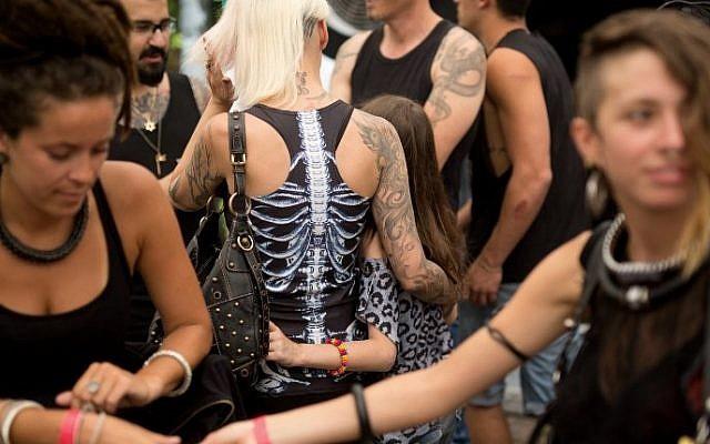 Visitors take part in the three-day annual tattoo festival on June 6, 2015 in Tel Aviv (Menahem Kahana/AFP)