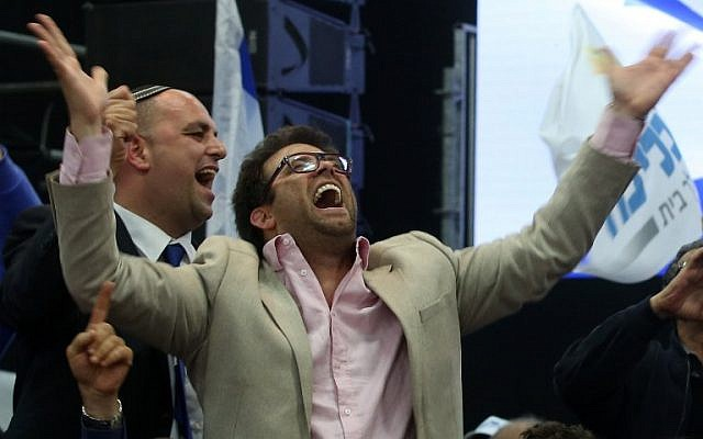 Oren Hazan celebrating the exit polls at the Likud headquarters after the elections, Tel Aviv, March 18, 2015. (AFP/Menahem Kahana)