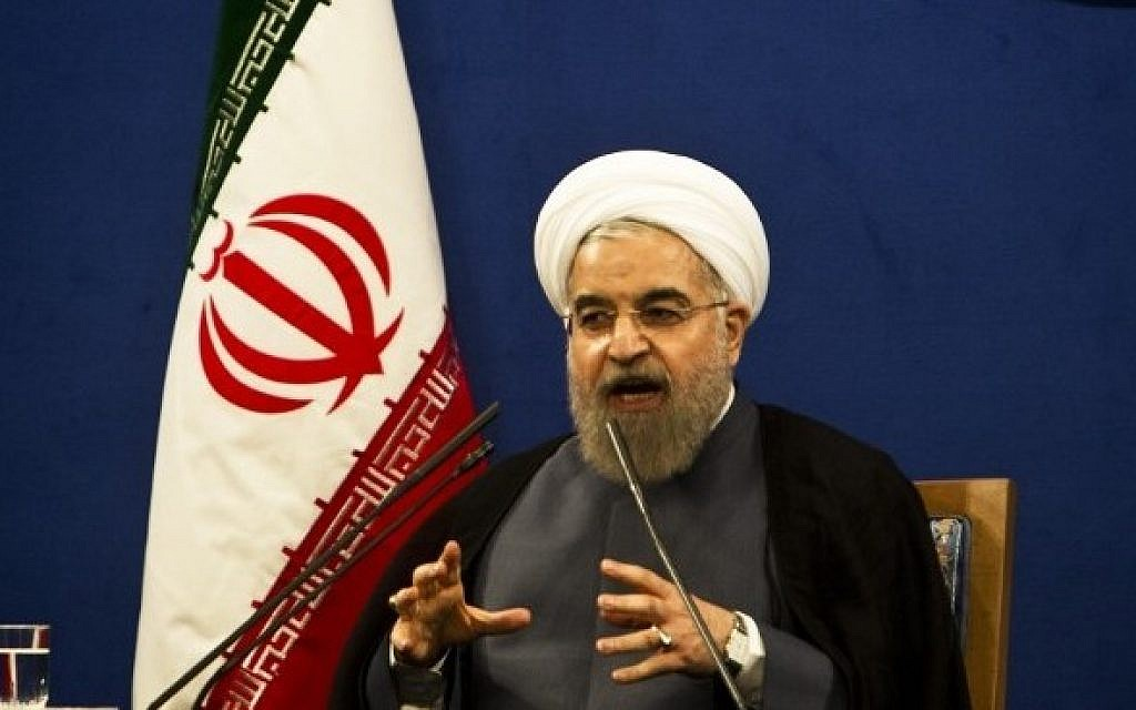 Iranian President Hassan Rouhani speaks during a press conference in Tehran on June 13, 2015. (AFP/Behrouz Mehri)