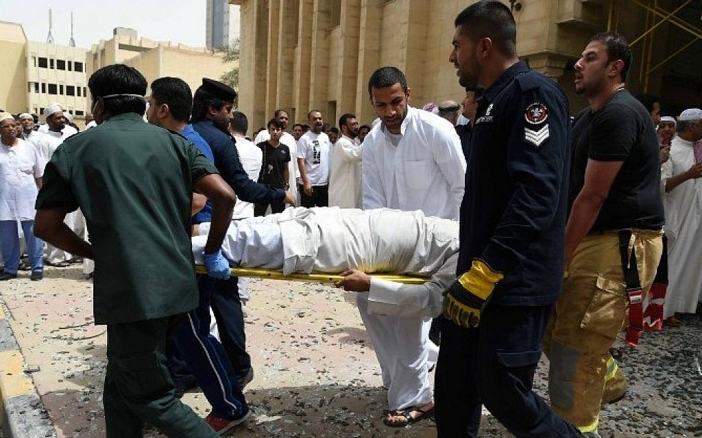 Kuwaiti security personnel and medical staff carry a man on a stretcher at the site of a suicide bombing that targeted the Shiite Al-Imam al-Sadeq mosque after it was targeted by a suicide bombing during Friday prayers on June 26, 2015, in Kuwait City. (AFP PHOTO / STR)