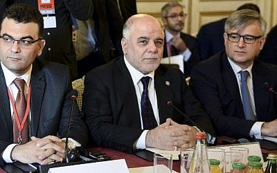 Iraqi Prime Minister Haider al-Abadi (C) and members of the anti-Islamic State coalition meet on June 2, 2015 in Paris, to discuss strategy in fighting the jihadists who have made key battlefield advances in recent weeks in Iraq and Syria. (AFP/ POOL/STEPHANE DE SAKUTIN)