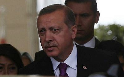 Turkish President Tayyip Erdogan looks on after arriving at Esenboga Airport, in Ankara, on June 8, 2015 after Erdogan's ruling party lost its absolute majority in parliament for the first time since coming to power in 2002. (AFP/ADEM ALTAN)