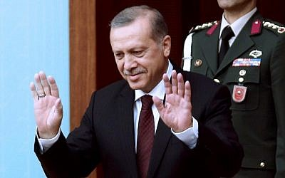 Turkey's President Recep Tayyip Erdogan greets members of parliament as he arrives for a swearing-in ceremony at the Turkish parliament in Ankara, Turkey, June 23, 2015. (AFP/ADEM ALTAN)