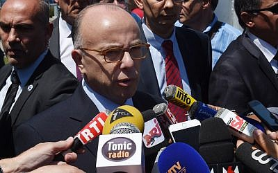 File: French Interior Minister Bernard Cazeneuve at a press conference in Saint-Quentin-Fallavier near Lyon, southeastern France, on June 26, 2015. (AFP Photo/Philippe Desmazes)