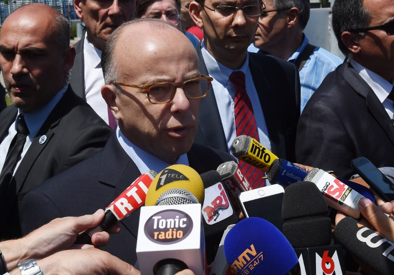 French Interior Minister Bernard Cazeneuve gives a press conference near the entrance of the Air Products gas factory in Saint-Quentin-Fallavier near Lyon, southeastern France, on June 26, 2015. (AFP PHOTO / PHILIPPE DESMAZES)