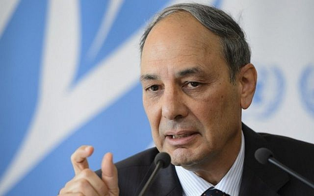 Israel's representative to the UN Human Right Council Eviatar Manor speaks to reporters following the report of the Commission of Inquiry on the 2014 Gaza war, in Geneva, Switzerland, June 29, 2015. (AFP/Fabrice Coffrini)