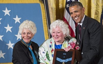 US President Barack Obama presents the Medal of Honor to Elsie Shemin-Roth center, and Ina Bass left, accepting on behalf of their late father, Army Sergeant William Shemin, for actions while serving in France during World War I, during a ceremony in the East Room of the White House in Washington, DC, June 2, 2015. (AFP/SAUL LOEB)