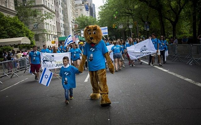 People take part in the Celebrate Israel Parade along Fifth Avenue May 31, 2015 in New York City.  (Eric Thayer/Getty Images/AFP)