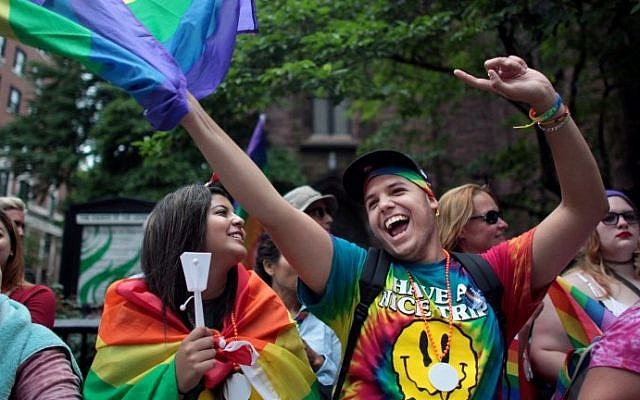 People watch the Gay Pride Parade in New York City on June 28, 2015 (Yana Paskova/Getty Images/AFP)