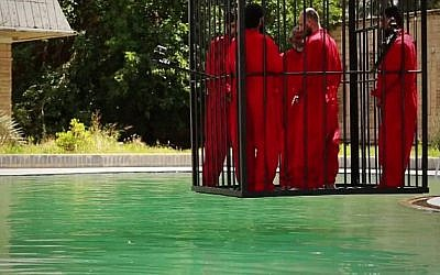 Islamic State jihadists lower five men into a pool to drown, in a video released June 23, 2015. (Screen capture)
