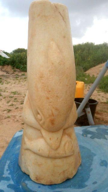 A statuette of a dolphin found near Kibbutz Magen, near the Gaza Strip. (Clara Amit, Israel Antiquities Authority)