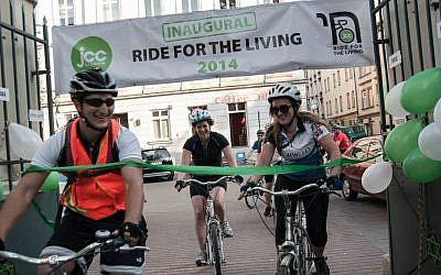 Robert Desmond (left) at the finish line of the 'Ride for the Living' in June 2014. (Courtesy)
