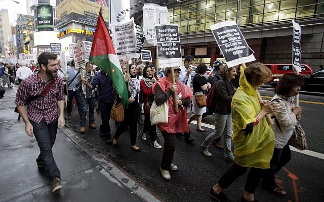 Palestinian and Jewish groups supporting the Palestinian cause walk from Times Square to the United Nations Building during a rally, Thursday, Sept. 15, 2011, in New York (AP/David Karp)