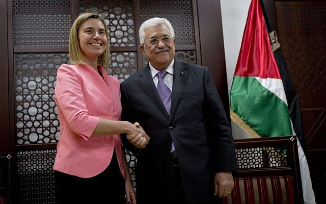 European Union foreign policy chief Federica Mogherini shakes hands with Palestinian President Mahmoud Abbas during their meeting in the West Bank city of Ramallah, Wednesday, May 20, 2015 (AP/Majdi Mohammed)