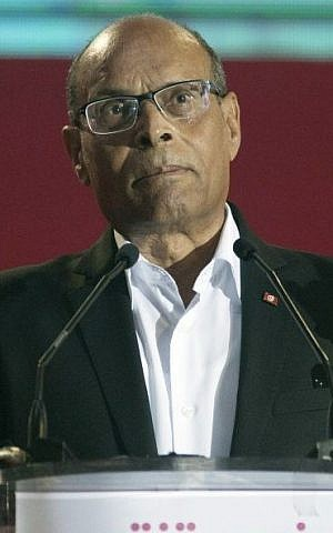 Former Tunisian President Moncef Marzouki gestures as he speaks during a campaign meeting in Tunis, Tunisia, Sunday, December 14, 2014 [AP/Aimen Zine]