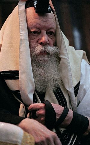Menachem Schneerson, Rebbe of the Jewish ultra-Orthodox Chabad-Lubavitch movement, listens to a Torah reading during morning prayers at the Lubavich headquarters in Brooklyn, N.Y., in March 1992. (AP Photo/Mike Albans)
