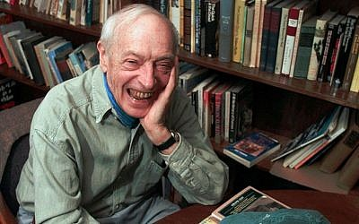 Saul Bellow laughs during a 1997 interview in his office at Boston University, where he taught literature. (AP Photo/Elise Amendola)