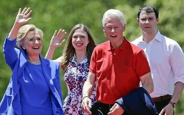 File: Democratic presidential candidate Hillary Clinton waves to supporters as her husband former president Bill Clinton, second from right, Chelsea Clinton, second from left, and her husband Marc Mezvinsky, join on stage Saturday, June 13, 2015, on Roosevelt Island in New York. (AP Photo/Frank Franklin II)