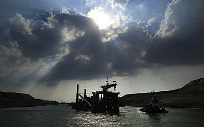 A dredger works on a new section of the Suez canal during a media tour in Ismailia, Egypt, Saturday, June 13, 2015.   (AP Photo/Hassan Ammar)
