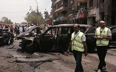 Emergency personnel inspect damage after a bomb attack targeted Egypt's state prosecutor in the Heliopolis district of Cairo, Egypt, June 29, 2015. (AP Photo/Ahmed Hatem)