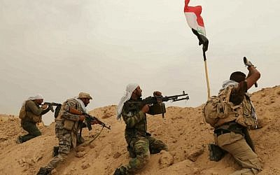 Fighters from the Badr Brigades Shiite militia clash with Islamic State fighters at the front line on the outskirts of Fallujah, Anbar province, Iraq, Monday, June 1, 2015. (AP Photo/Hadi Mizban)