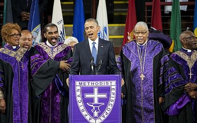 President Barack Obama sings 'Amazing Grace' during services honoring the life of Rev. Clementa Pinckney, Friday, June 26, 2015, at the College of Charleston TD Arena in Charleston, SC. Pinckney was one of the nine people killed in the shooting at Emanuel AME Church last week in Charleston. (AP Photo/David Goldman)