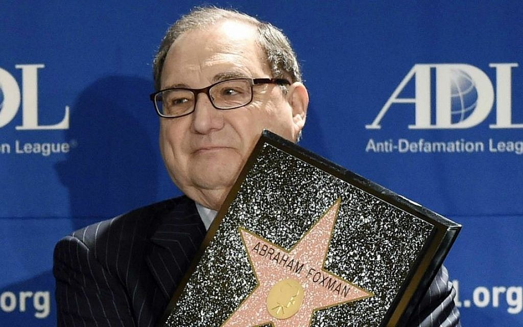 Abraham Foxman holds a replica of his Hollywood Walk of Fame Star as he is honored by the ADL's 2014 Annual Meeting at The Beverly Hilton in Beverly Hills, California, on November 7, 2014. (Kevork Djansezian/Getty Images/JTA)