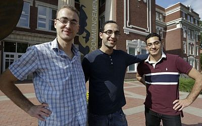 Syrian brothers Mohammad Kayali, left, Ebrahim Kayali, right and Molham Kayali, center, pose for a photograph on the Emporia State University campus in Emporia, Kansas, Wednesday, May 6, 2015 (AP Photo/Orlin Wagner)