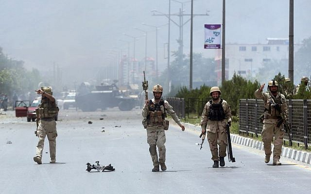 Afghan security forces inspect the site of a suicide attack during clashes with Taliban fighters in front of the Parliament, in Kabul, Afghanistan, June 22, 2015. (AP/ Massoud Hossaini)