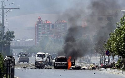 Fire and smokes rise at the site of a suicide attack during clashes with Taliban fighters in front of the Parliament, in Kabul, Afghanistan, Monday, June 22, 2015. (AP/Massoud Hossaini)