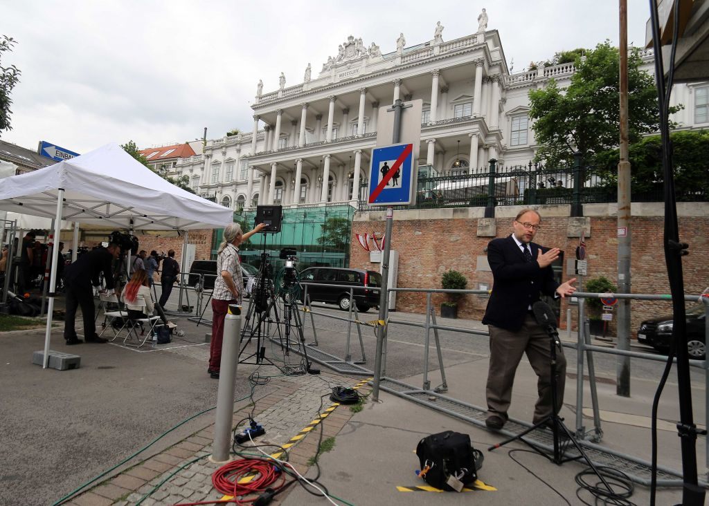 Journalists waiting in front of Palais Coburg where closed-door nuclear talks with Iran take place in Vienna, Austria, Saturday, June 27, 2015. (AP Photo/Ronald Zak)