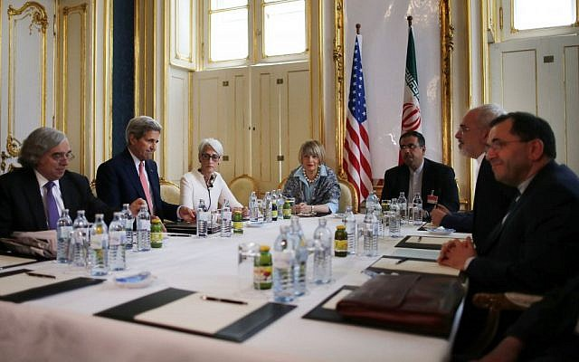 From left, US Secretary of Energy Ernest Moniz, US Secretary of State John Kerry and US Under Secretary for Political Affairs Wendy Sherman meet with Iranian Foreign Minister Mohammad Javad Zarif, second from right, at a hotel in Vienna, Austria, Saturday, June 27, 2015. (Carlos Barria/Pool via AP)
